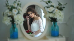 Beautiful the bride looks in the mirror Stock Footage
