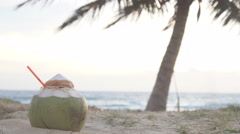 Fresh coconut with drinking straw on tropical beach, Thailand Stock Footage