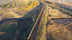 View from the sky on a freight train loaded with coal, unmanned flight over the Stock Footage