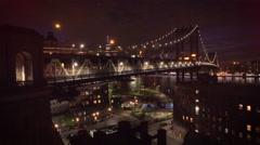 Rising over Manhattan Bridge revealing New York City night view Stock Footage