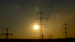 Sunset on a background of a high-voltage line Stock Footage