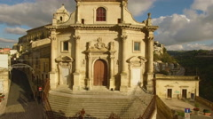 Rising past church to reveal Ragusa Ibla Sicily Stock Footage