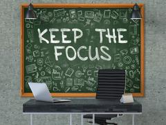 Chalkboard on the Office Wall with Keep the Focus Concept. 3D Stock Illustration