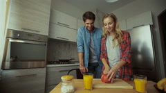 Young lady making breakfast for her man Stock Footage