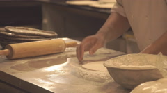 The chef prepares the pizza.Thin dough.Rolls out the dough. The kitchen in the Stock Footage