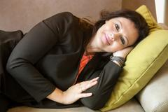 Woman in her 40s lying on couch and resting Stock Photos