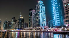 View of the towers in the district Dubai Marina at night. Timelapse, hyperlapse Stock Footage
