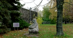 "The sculpture ""Oriental motif"" among the big trees of the city Park Stock Footage"