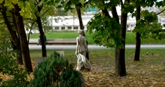 """Erotic Sculpture """"Nude"""" is made of metal in the Park among the trees Stock Footage"""