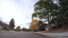 POV point of view - Driving through residential neighborhood. Stock Footage