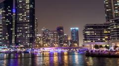 Dubai, UAE : views of the Dubai Marina district at night. Time lapse Stock Footage