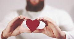 Bearded man hands giving Heart shape Love and Health symbol Stock Footage