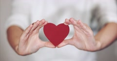 Woman hands holding Heart shape Love and Health symbol Stock Footage