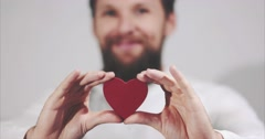 Bearded man hands holding Heart shape Love and Health symbol Stock Footage