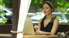 Woman working on laptop in cafe and answering the call, selective focus Stock Footage