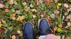 Top of view of autumn season on walking sport shoes in slowmotion. 1920x1080 Stock Footage