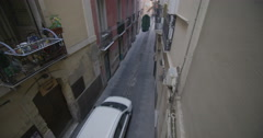 4K Car driving through narrow Italian street with rows of apartments. No people. Stock Footage