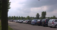 Row of cars in parking area, The Netherlands Stock Footage