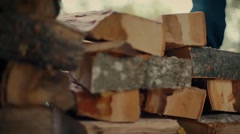 Stacking wood logs in the autumn. Preparing for winter. Stock Footage