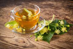 Green herbal tea with linden flowers Stock Photos