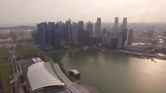 Singapore skyline day view pulling back over Marina Bay Sands Hotel Stock Footage