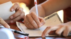 Woman signs a document Stock Footage