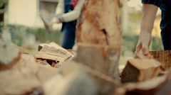 Grandfather and grandson preparing for the winter. Cutting wood. Autumn. Stock Footage