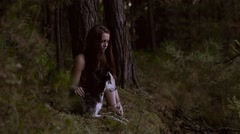 Likely girl sitting in nature with her wolf-looking dog Stock Footage