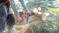 Gas chainsaw real time cutting logs. Stock Footage