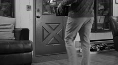 Black and white trick or treating inside house view Stock Footage