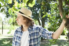 Young man contemplating under tree in vineyard, portrait Stock Photos