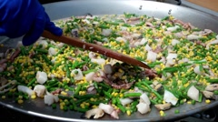 Street food festival, vegetables, marine reptiles, asparagus and corn, cooked on Stock Footage