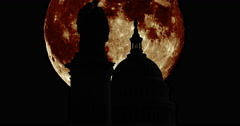 Silhouettes of the Peace Monument in Washington DC with giant moon Stock Footage