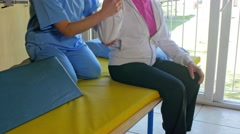 Asian nurse helping elder woman in exercising inside a gym Stock Footage