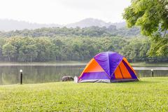 Dome tents camping in forest Stock Photos