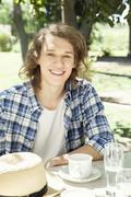 Young man enjoying coffee outdoors Stock Photos