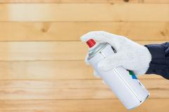 Hand holding spray paint can Kuvituskuvat