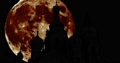 Silhouettes of the Spilled Blood with giant moon Stock Footage
