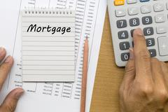 Planning monthly Mortgage payment Stock Photos