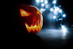 Scary Halloween pumpkins on a blue light background. Stock Photos