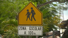 Children crossing road sign Stock Footage