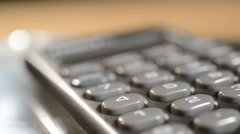 Detail of calculator. Shallow depth of field. The calculator moves around. Stock Footage