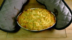 Oven gloves and a hot fish pie. Stock Footage