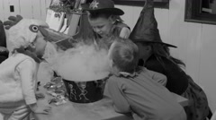 Black and white kids around a foggy halloween punch bowl Stock Footage