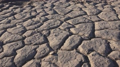 Dry lake bottom , cracked earth, pan Stock Footage