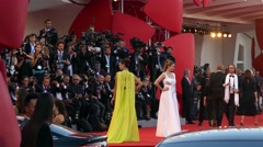 Top models Barbara Palvin, Anna Safroncik posing in front of cameras red carpet Stock Footage