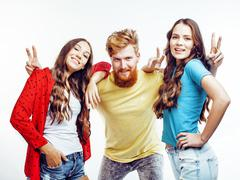 Company of hipster guys, bearded red hair boy and girls students having fun Stock Photos