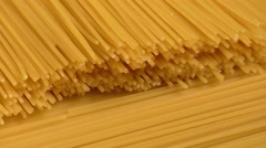 Raw yellow long spaghetti.Thin pasta arranged in rows. Stock Footage