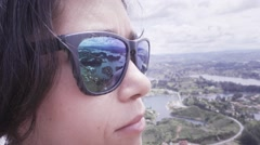 Watching horizon with blue sunglasses Stock Footage