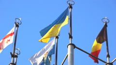 Several flags on background of blue sky Stock Footage